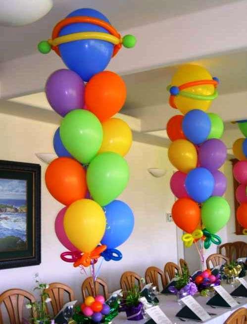 Игрушка - погремушка из воздушных шариков - бабочка - в крылышках яркие колечки и шарики